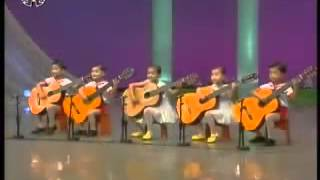 North Korea children playing the guitar