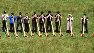 22 Alphorns Play in Switzerland